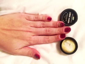 Olive & June manicure being hyrdated with Lush Cuticle Butter